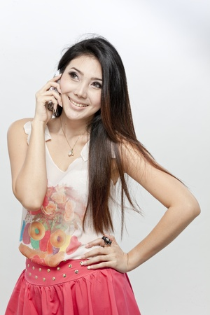 Asian woman in blouse and pink skirt photo