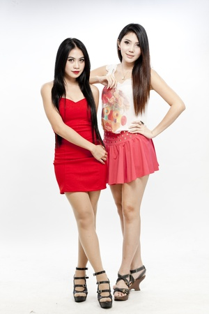 Two attractive Asian women in dress and skirt photo