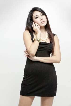 Elegant woman in black dress on the phone photo