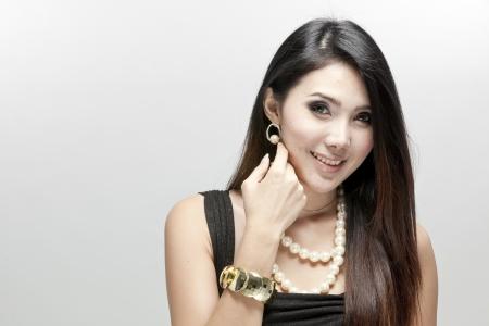 Elegant woman in black dress against white background Stock Photo - 23636992