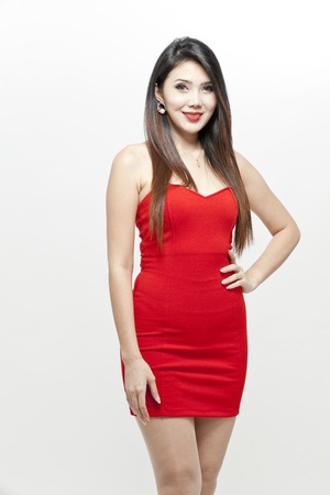 Fashion model wearing red dress
