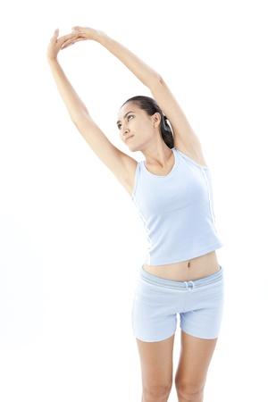 Young beautiful woman exercising Stock Photo - 24011403