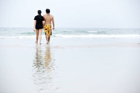 Couple walking on beach photo
