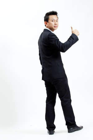 Businessman is showing hand gesture photo