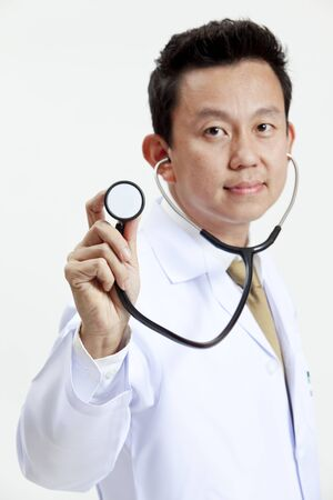 Portrait of doctor holding the stethoscope photo