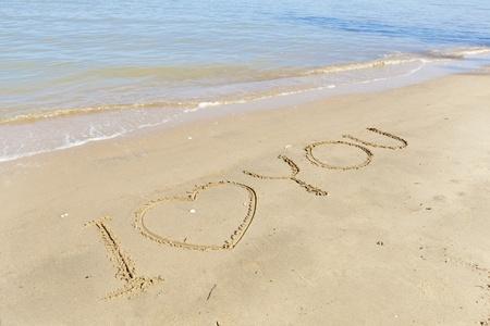 I love you handwritten in sand photo