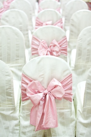wedding chairs: Pink ribbons of wedding chairs Stock Photo