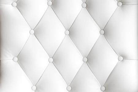 button tufted: White leather fabric from the sofa Stock Photo