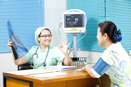 Healthcare professional showing X-ray scan