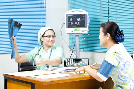 Healthcare professional showing X-ray scan Stock Photo - 24022871