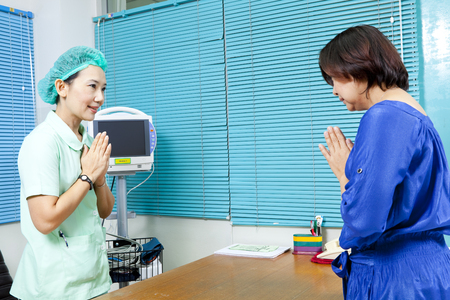 Healthcare professional and patient greeting each other photo