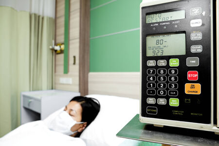 isotonic: Volumetric infusion pump with a patient in the background