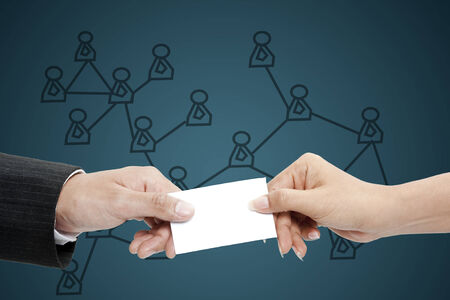 smart investing: Business people exchanging business card  Stock Photo