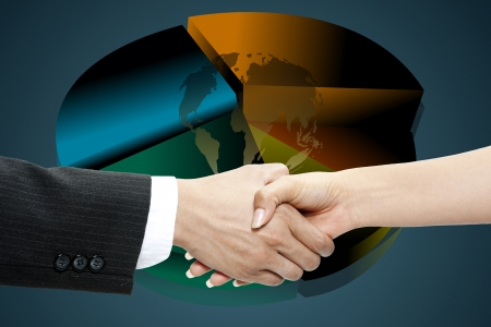 Business people exchanging a handshake with a pie chart at the back photo
