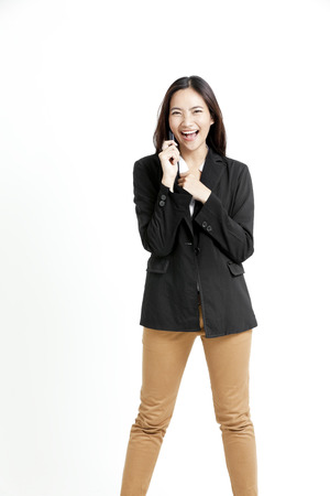 khakis: Pretty Asian woman in a call with happy expression
