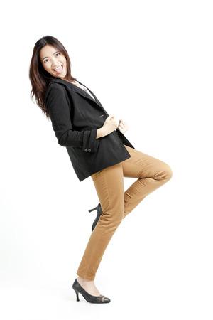 overjoyed: Pretty Asian woman in jacket and khakis overjoyed