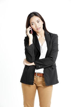 khakis: Pretty Asian woman in a call looking sideways