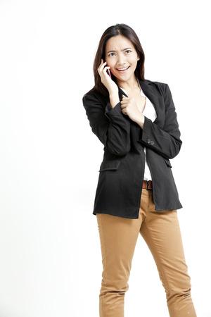 khakis: Pretty Asian woman in a call Stock Photo