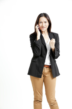 khakis: Pretty Asian woman in a call with angry expression Stock Photo