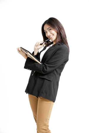 khakis: Pretty Asian woman holding pen and documents Stock Photo