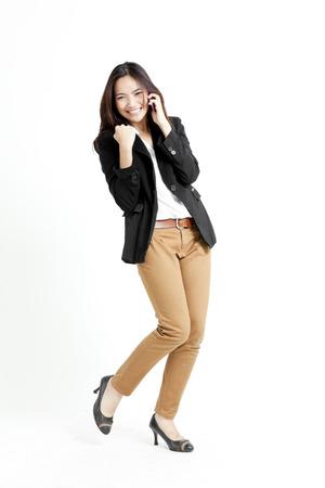 Pretty Asian woman in a phone call