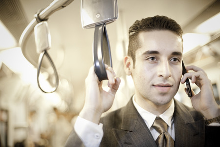 travelling salesman: A businessman on the phone in a train Stock Photo