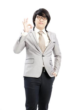 posing  agree: Asian man giving an okay sign
