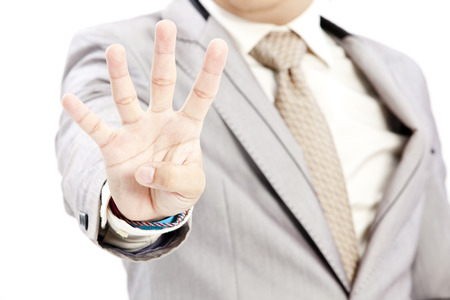Asian man showing four fingers Stock Photo