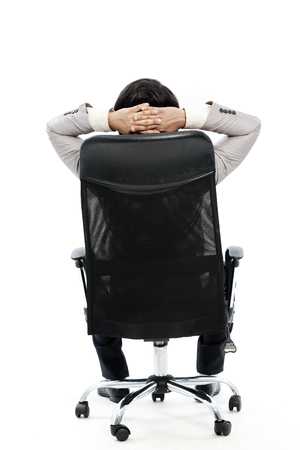 Backview of businessman sitting on comfortable office chair  Stock Photo