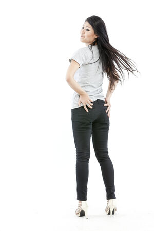 Backview of woman posing in style