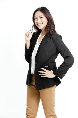 khaki pants: Pretty woman in black jacket Stock Photo