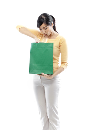 Young woman with a green shopping bag photo