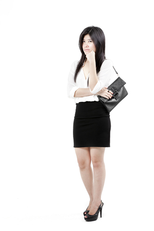 Young woman holding a black handbag photo