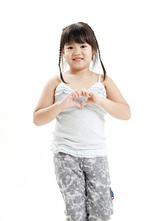 Girl forming a heart shape with hands photo