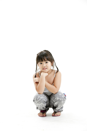 girl squatting: Girl squatting and posing for the camera