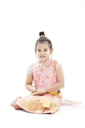 Girl dressed up in traditional Thai clothings