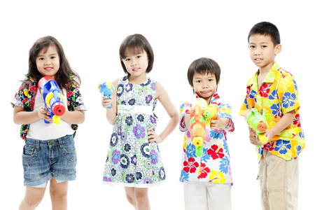 Children posing with toy guns in casual attire Stock Photo - 28639196