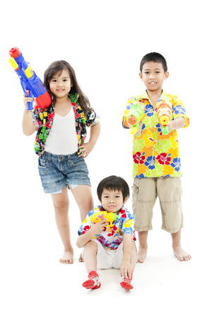Children posing with toy guns in casual attire Stock Photo - 28669794