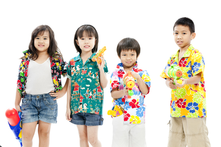 Children posing with toy guns in casual attire Stock Photo - 28639197