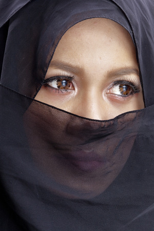 modesty: Woman wearing a hijab and covering half her face with a scarf