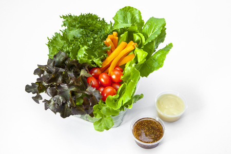 Close up of fresh vegetables and sauce photo
