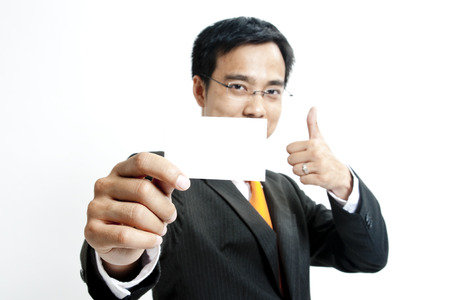 Businessman showing a blank card photo
