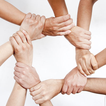 people together: Multiple hands joining together