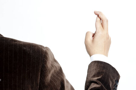hope indoors luck: Businessman with fingers crossed