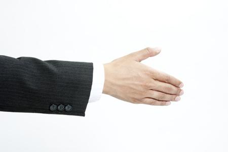 Businessman offering a handshake Stock Photo - 30486159