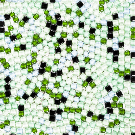 Background of light green and black tiles