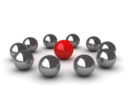 steel balls: Ten chromeplated balls around of one red ball symbolize - LEADERSHIP Stock Photo