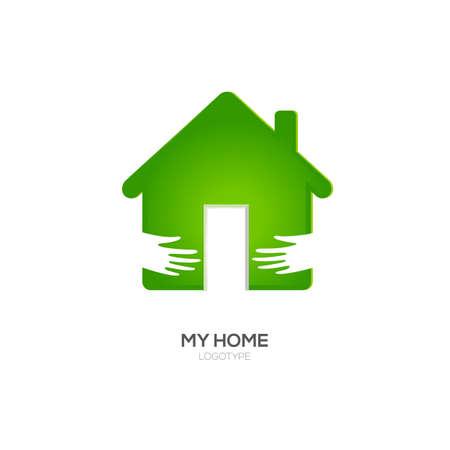 Two hands hug green house
