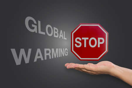 stop global warming: Educational and Creative composition with the message Stop Global Warming on the blackboard Stock Photo