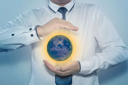 protectors: Ecology Earth Concept - Protectors of the Earth. Stock Photo